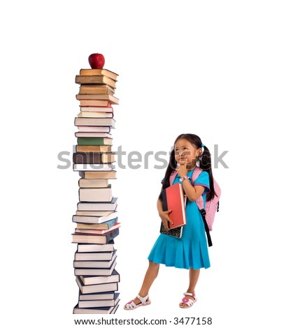 Going to school is your future. Education, learning, teaching. A young girl looks at a tall pile of books. - stock photo