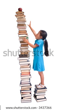 Going to school is your future. Education, learning, teaching. A young girl reaches for an apple and pencil on a tall tower of books. Reaching high for your goals. - stock photo