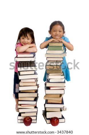Going to school is your future. Education,  Two young sisters lean on piles of big books. - stock photo