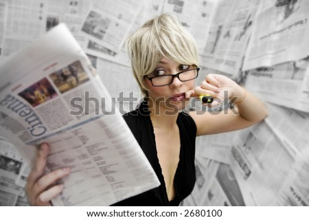 going to the movies: woman checking out movies reviews - stock photo