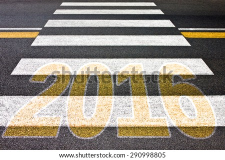 Going toward 2016 - Pedestrian crossing with 2016 written on it - concept image