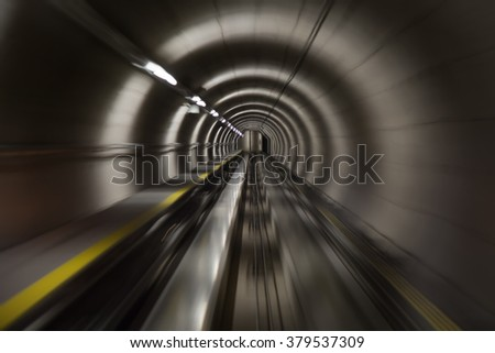 Going trough the underground tunnel  - stock photo