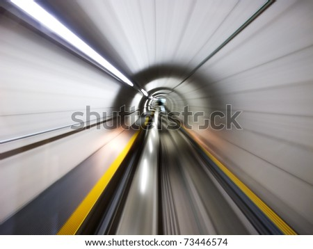 Going trough the underground tunnel (Zurich airport) - stock photo