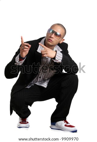 Going Up Young man in stylish business fashion with sunglasses on - over white background. - stock photo