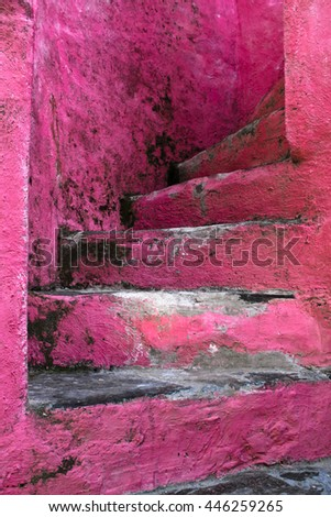 going upstairs on pink stairs - stock photo