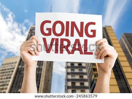 Going Viral card with a skyscraper background - stock photo