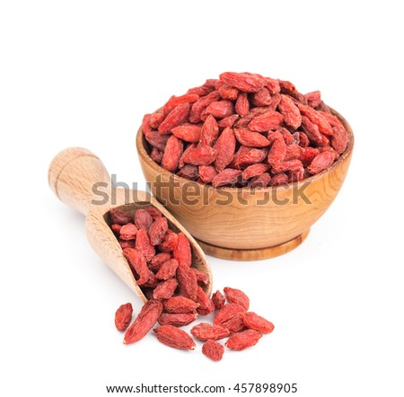 Goji berries in a wooden bowl isolated on white - stock photo