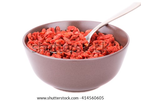 Goji berries in brown bowl isolated on white background. - stock photo