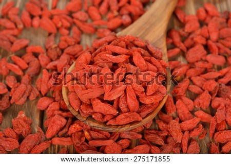 Goji berries on a brown background - stock photo