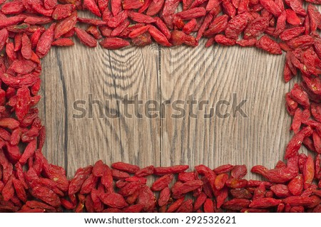 goji berries on a rustic wooden background - stock photo