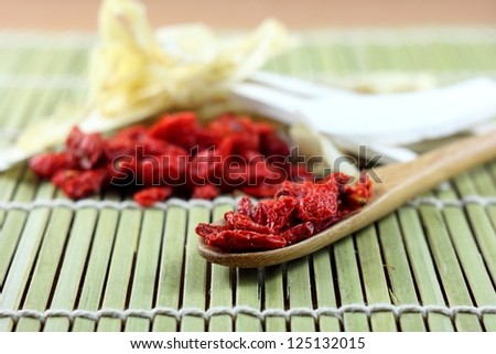 goji berry in wooden spoon and chinese spices - stock photo