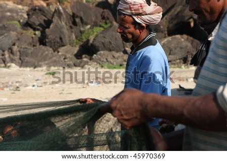 GOKARNA, INDIA - DECEMBER 14: Fishermen from Indian state Karnataka, prepare gear for fishing in the Indian ocean, December 14, 2008 in Gokarna, India. - stock photo