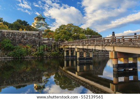 Gokurakubashi bridge and Osaka Castle with morning sunrise in autumn season, Osaka, Japan