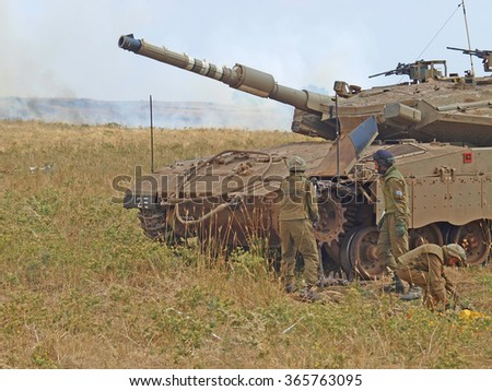 Golan Heights, Israel - January 13, 2012: Merkava tanks and Israeli soldiers in training armored forces in the Golan Heights