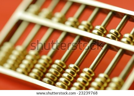 gold abacus on red - stock photo