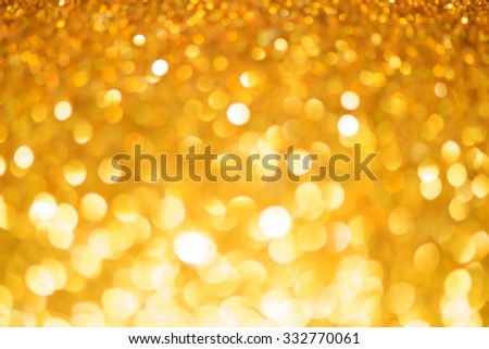 Gold. Abstract bokeh lighting background. abstract texture spring or summer, Christmas Glittering Holiday