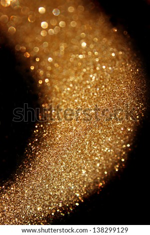 gold abstract glitter trail background made of defocused lights - stock photo