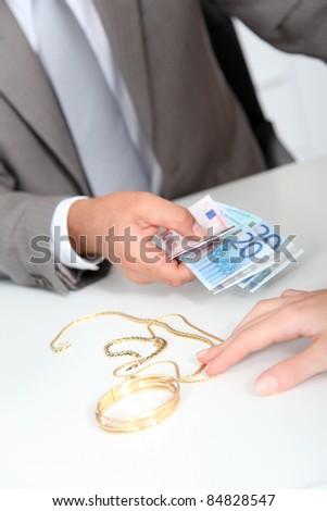 Gold against cash money - stock photo
