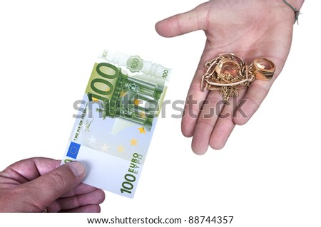 Gold against cash money on white background - stock photo