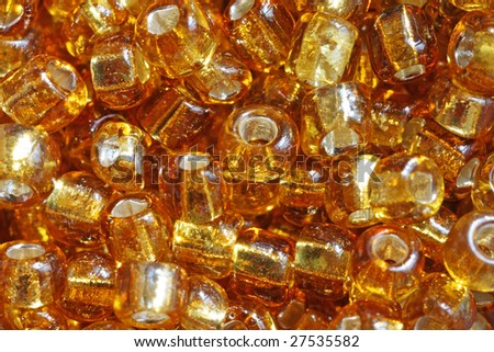 Gold amber beads, supermacro. - stock photo