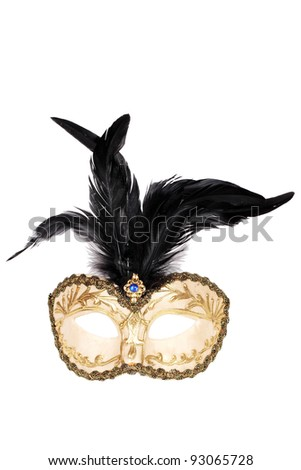 Gold and black feathered mask isolated over white with clipping path.