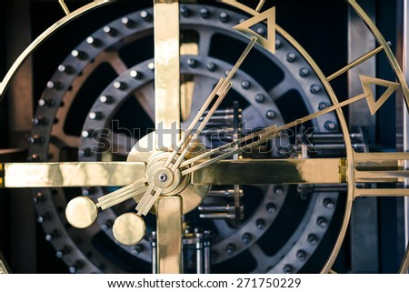 Gold and blue clock detail, orthogonal view - stock photo