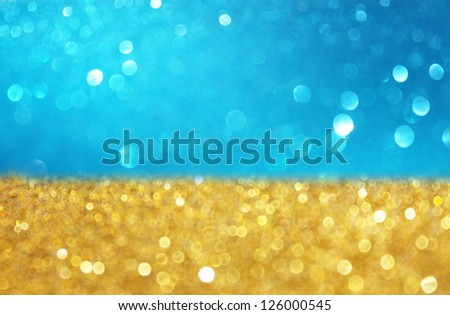 gold and blue fefocused lights background - stock photo