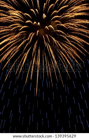 gold and blue firework explosion