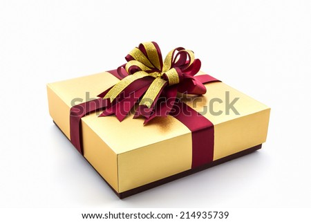 Gold and brown gift box with ribbon bow on white background.