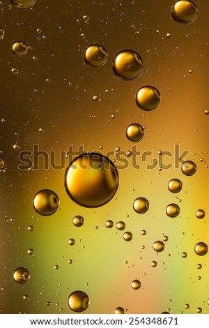 Gold and brown three dimensional looking oil and water abstract