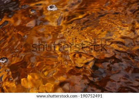 Gold and brown water from moors - stock photo