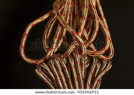 Gold and metallic red rope showing textures and intricate patterns