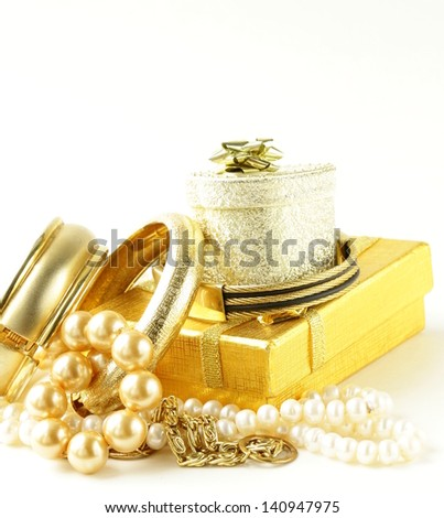 gold and pearl jewelry, gift boxes on a white background - stock photo