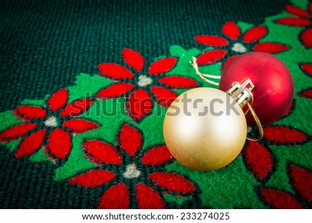 gold and red ball on christmas carpet , use for background - stock photo