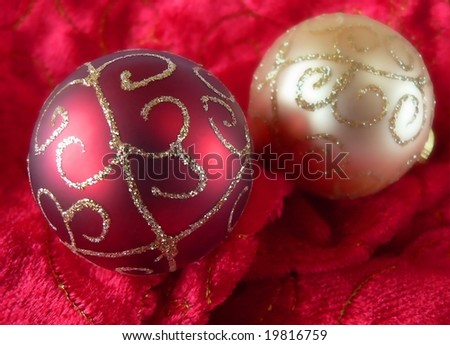 gold and red christmas ornaments on soft red and gold fabric