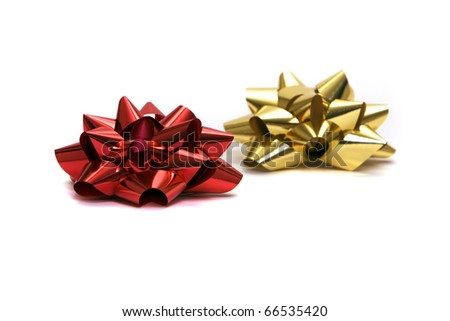 Gold and red gift bows on white background