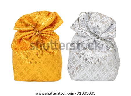 gold and Silver bag in white background. - stock photo