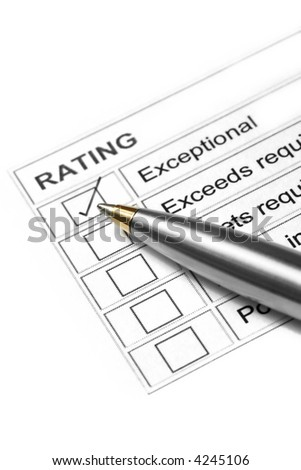 "Gold and silver ballpoint marking an ""exceptional""  rating. - stock photo"