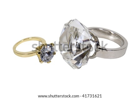 Gold and silver diamond engagement rings with facets that sparkle brightly in the light symbolizing eternity of love - path included
