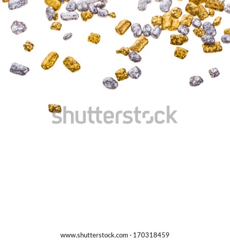 gold and silver grains of small size, scattered in disarray isolated on white background - stock photo