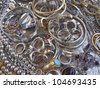 gold and silver jewels closeup - stock photo