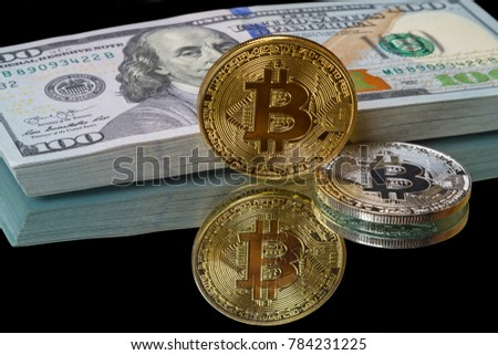 Gold and silver mounts bitcoin and a pack of dollar on a black background