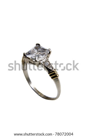 gold and silver ring with gemstone over white background - stock photo