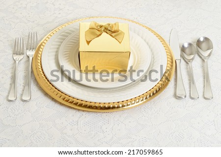gold and silver table setting - stock photo