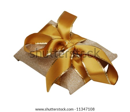 Gold and yellow ribbon around gold textured wrapping paper.