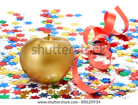 Gold apple with a red ribbon