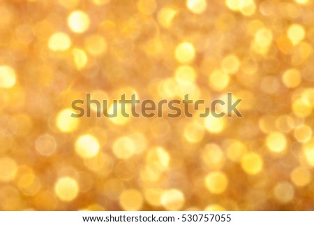 Gold background. Golden bokeh. Out of focus. Defocused bokeh lights. Background of light.