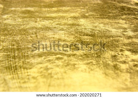 gold background, photographed at an angle - stock photo