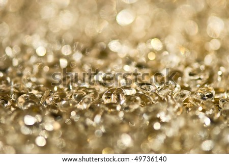 Gold background with a line of transparent droplets - stock photo