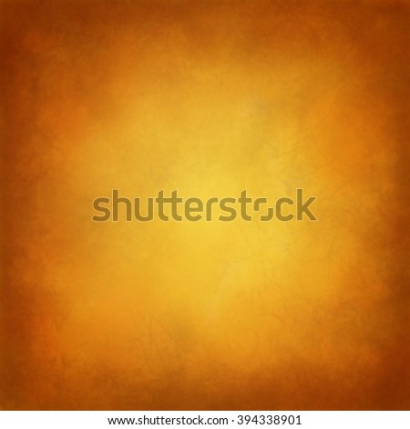 gold background with orange and brown hues in Tuscan style background color, warm golden center and brown vintage border, distressed texture and soft lighting, elegant studio background - stock photo